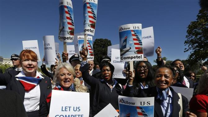 Flight attendants chant at pro merger protest in front of the U.S. Capitol building on Capitol Hill in Washington