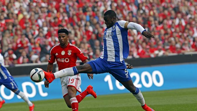 Benfica's Eliseu Santos fights for the ball with Porto's Jackson Martinez during their Portuguese Premier League soccer match at Luz stadium in Lisbon