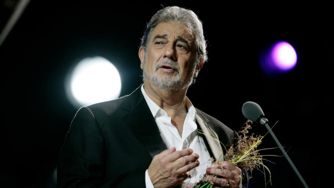 """FILE - In this Oct. 4, 2008 file photo,Tenor Placido Domingo performs in concert at the Mayan ruins of Chichen Itza in the Yucatan peninsula in Mexico. American television audiences will see something unique this week — filmed live in the streets and palaces of an Italian city: Verdi's """"Rigoletto"""" with Placido Domingo, singing right where the story is set. The performance starts Friday, July 15, 2011 at 9:30 PM EDT.  (AP Photo/Israel Leal, File)"""