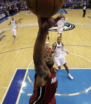 Miami Heat's Dwyane Wade goes up for a rebound during the first half of Game 3 of the NBA Finals basketball game against the Dallas Mavericks Sunday, June 5, 2011, in Dallas. (AP Photo/David J. Phillip; Pool)