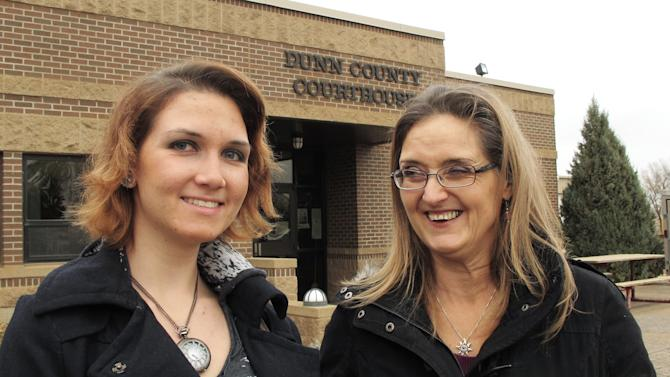 In this Oct. 29, 2012 photo, Patty Caldwell, right, a former Oregon resident and owner of a cleaning business in New Hradec, N.D., and her daughter, Amanda Caldwell, who also works in the business, stand outside the Dunn County courthouse in Manning, N.D., shortly after they voted early for the Nov. 6 election. The Caldwells moved to North Dakota because of available work in the state's oil-producing region, and they are voting in North Dakota for the first time this year. (AP Photo/Dale Wetzel)