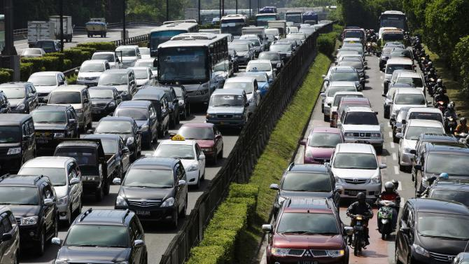 File photo of a traffic jam on a toll road towards the Soekarno-Hatta International Airport in Jakarta
