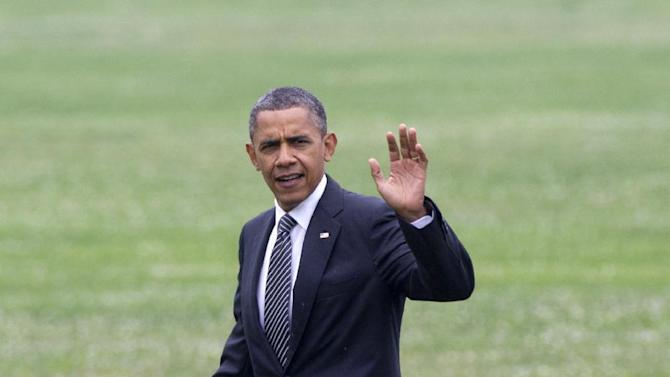President Barack Obama waves as he walks across a grass field upon his arrival at McDonogh School in Owings Mills, Tuesday, June 12, 2012.  (AP Photo/Carolyn Kaster)