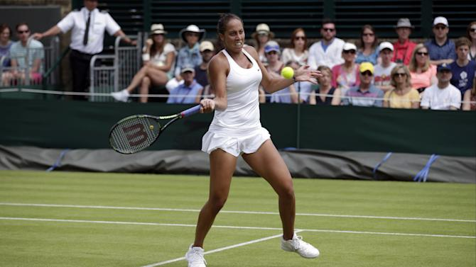 Madison Keys of the United States returns a ball to Olga Govortsova of Belarus, during their singles match at the All England Lawn Tennis Championships in Wimbledon, London, Monday July 6, 2015. (AP Photo/Pavel Golovkin)
