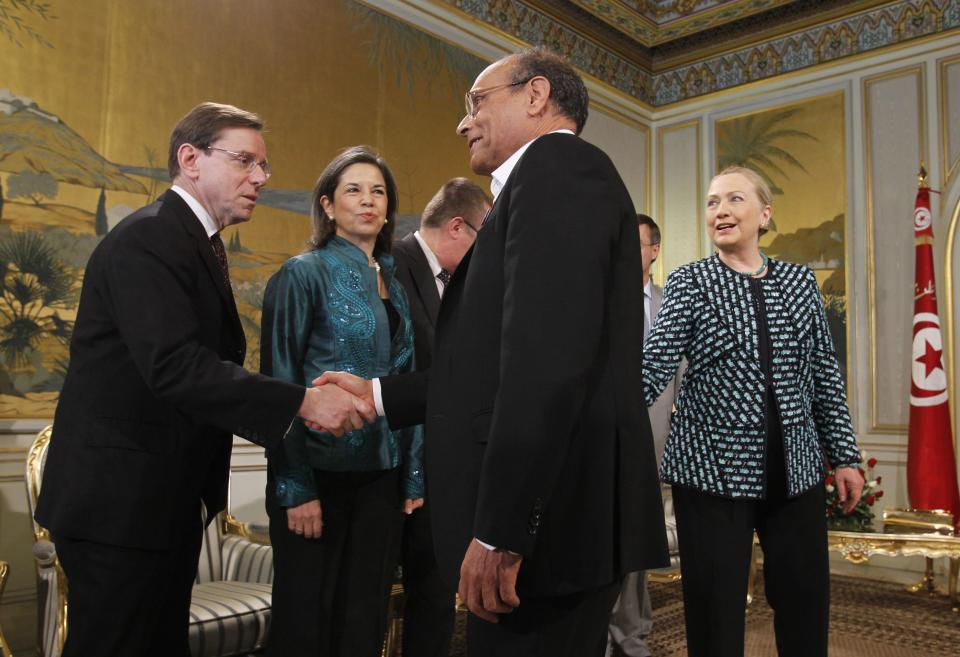 U.S. Secretary of State Hillary Rodham Clinton, right, introduces members of her delegation as they meet with Tunisia's President Moncef Marzouk, center, at the Presidential Palace in Carthage, Tunisia, Saturday Feb. 25, 2012. (AP Photo/Jason Reed, Pool))