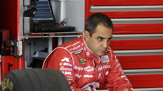 Juan Pablo Montoya, of Colombia, waits in his garage before going out on the track during the final practice for the NASCAR Daytona 500 Sprint Cup Series auto race at Daytona International Speedway, Saturday, Feb. 23, 2013, in Daytona Beach, Fla. (AP Photo/John Raoux)