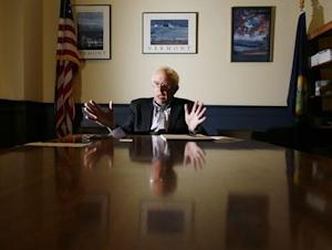 Senator-elect Bernie Sanders is interviewed by a Reuters reporter at Sanders' office in Burlington