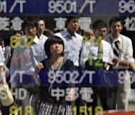 Asian markets mostly rose on Friday after a strong rally on Wall Street while dealers absorbed data showing China's economy grew at its slowest pace in almost three years in the first quarter