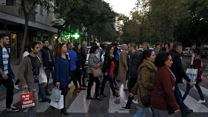 People carry shopping bags during the Black Friday sales in Malaga
