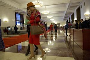 Chinese women arrive for a reception to commemorate …
