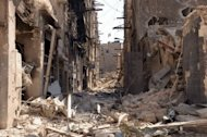 Rubble from destroyed buildings blocks a street in Aleppo, Syria. Fears that the Syrian civil war and the Iranian nuclear standoff could provoke wider international conflict dominated the debate on as world leaders gathered for the UN General Assembly