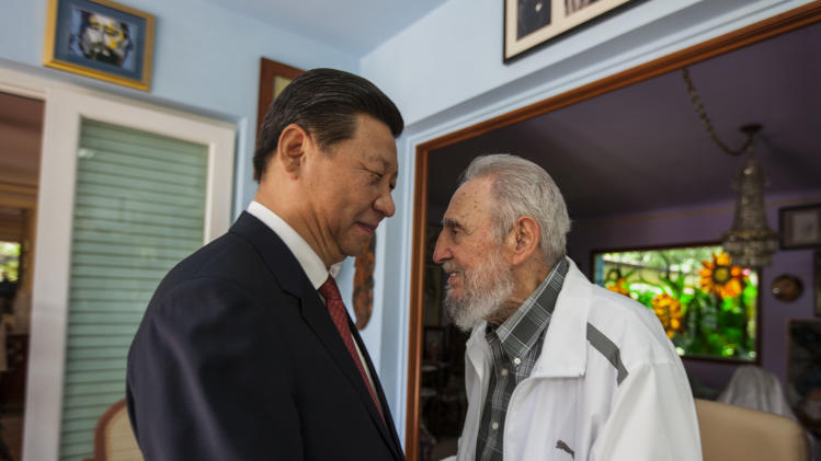 Cuba's Fidel Castro, right, speaks with China's President Xi Jinping in Havana, Cuba, Tuesday, July 22, 2014. Xi Jinping said that his state visit to Cuba is aimed at carrying forward the traditional friendship between the two countries jointly built by Castro and the older generations of Chinese leaders, so as to inject new impetus into bilateral cooperation. He also extended good wishes to Castro for his upcoming 88th birthday. (AP Photo/Alex Castro)