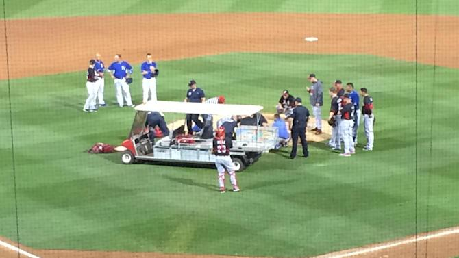 Aroldis Chapman is taken off the field after being hit by a line drive Wednesday night.
