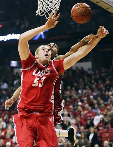 Bennett leads UNLV to 64-55 win over No. 15 Lobos