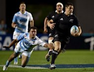 New Zealand's All Blacks fly half Dan Carter (R) eludes a tackle by Argentina's Los Pumas scrum half Martin Landajo, during their Rugby Championship fifth round match, at La Plata stadium in La Plata, Argentina, on September 29. New Zealand won 54-15
