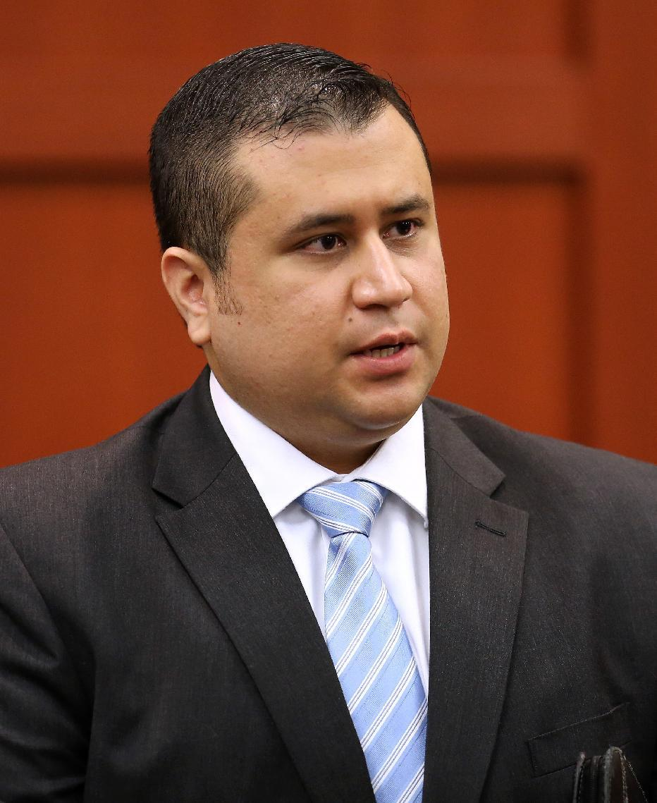 George Zimmerman, speaks with court personnel during a recess on the 16th day of his trial in Seminole circuit court, in Sanford, Fla., Monday, July 1, 2013. Zimmerman has been charged with second-degree murder for the 2012 shooting death of Trayvon Martin.(AP Photo/Orlando Sentinel, Joe Burbank, Pool)