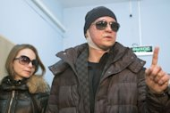 The Bolshoi Ballet's artistic director Sergei Filin leaves hospital accompanied by his wife Maria (L) in Moscow, on February 4, 2013. Filin has left Russia for Germany in the hope of recovering his eyesight after an acid attack, claiming he knew the mastermind behind the gruesome assault