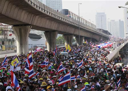 Anti-government protesters march during rally at major business district in Bangkok