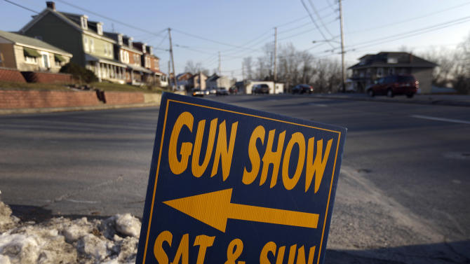 FILE - In a Friday, Jan. 4, 2013 file photo, a sign is posted for an upcoming gun show, in Leesport, Pa. Nearly six in 10 Americans want stricter gun laws in the aftermath of last month's deadly school shooting in Connecticut, with majorities favoring a nationwide ban on military-style, rapid-fire weapons and limits on gun violence depicted in video games and movies and on TV, according to a new Associated Press-GfK poll. A lopsided 84 percent of adults would like to see the establishment of a federal standard for background checks for people buying guns at gun shows, the poll showed. President Barack Obama was set Wednesday, Jan. 16, 2013 to unveil a wide-ranging package of steps for reducing gun violence expected to include a proposed ban on assault weapons, limits on the capacity of ammunition magazines and universal background checks for gun sales. (AP Photo/Matt Rourke)
