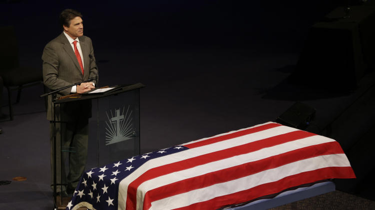Texas Gov. Rick Perry speaks during the memorial service for Kaufman County District Attorney Mike McLelland and his wife, Cynthia in Mesquite, Texas, Thursday, April 4, 2013.  McLelland and his wife were found shot to death Saturday in their house near Forney, about 20 miles east of Dallas. No arrests have been made. (AP Photo/LM Otero)