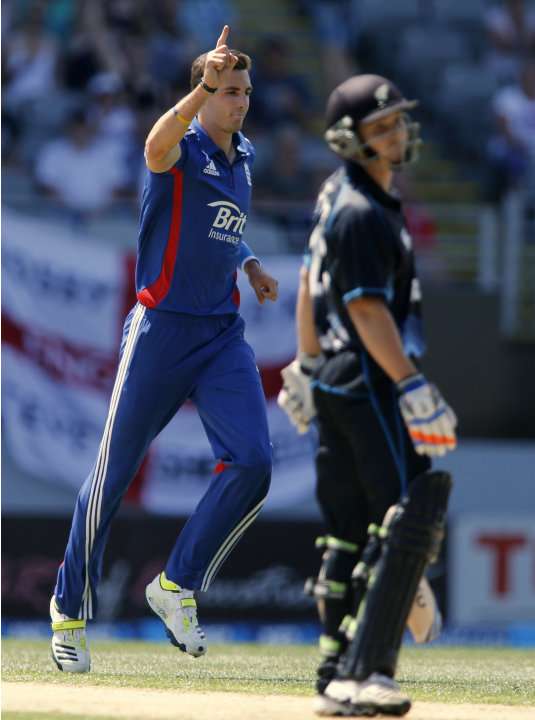 Steven Finn of England celebrates dismissing B.J Watling of New Zealand during the final ODI cricket match in Auckland