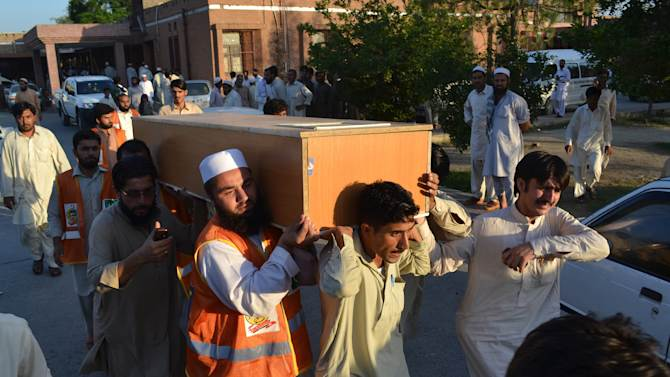 Pakistanis carry the casket of a victim of a suicide bombing at a hospital in Mardan, Pakistan, Tuesday, June 18, 2013. A suicide bomber blew himself up in a crowd of hundreds of mourners attending a funeral in northwestern Pakistan on Tuesday, killing tens of people. Among the dead was a newly elected lawmaker who may have been the target, authorities said. (AP Photo/Mohammad Sajjad)