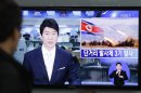 A South Korean man watches a TV news reporting missile launch conducted by North Korea, at a Seoul Train Station in Seoul, South Korea, Saturday, May 18, 2013. North Korea fired three short-range guided missiles into its eastern waters on Saturday, a South Korean official said. It routinely tests such missiles, but the latest launches came during a period of tentative diplomacy aimed at easing tensions. The letters at a screen read &quot; Fired three short-range guided missiles.&quot; (AP Photo/Ahn Young-joon)