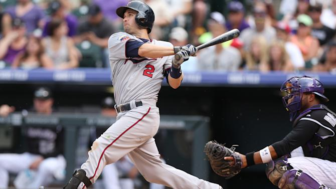 Dozier hits 2 homers as Twins beat Rockies 13-5