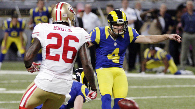St. Louis Rams kicker Greg Zuerlein, (4) makes a 54-yard field goal as San Francisco 49ers' Tramaine Brock, left, watches during overtime of an NFL football game, Sunday, Dec. 2, 2012, in St. Louis. The Rams won 16-13. (AP Photo/Tom Gannam)
