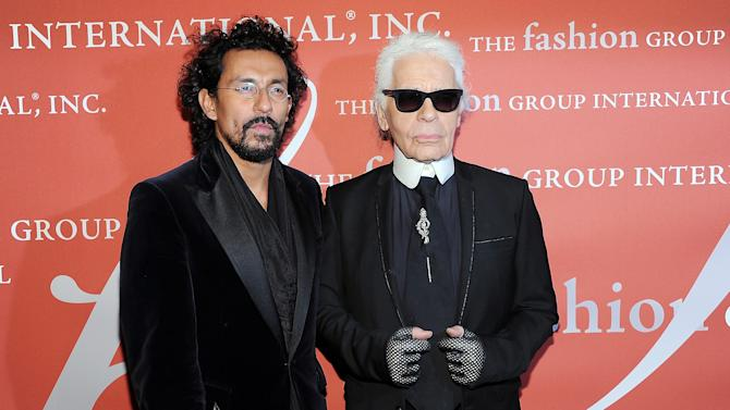 """""""Star"""" award honoree, designer Haider Ackerman, left, poses with presenter Karl Lagerfeld at the 29th Annual """"Night Of Stars"""" presented by The Fashion Group International at Cipriani Wall Street on Thursday Oct. 25, 2012 in New York. (Photo by Evan Agostini/Invision/AP)"""