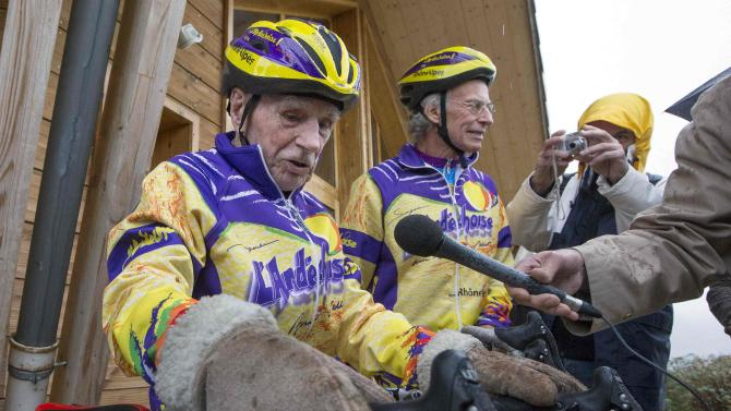 French cyclist Robert Marchand, 103 years-old, wears mittens as he prepares to ride the Robert Marchand pass near Saint-Felicien