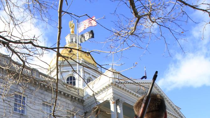 Gun owners rally to promote the right to bear arms in front of the Statehouse in Concord, N.H. Thursday Jan. 31, 2013. Speakers criticized Democrats in Washington for favoring new gun control laws following the Connecticut school shooting that left 26 dead last month. (AP Photo/Jim Cole)