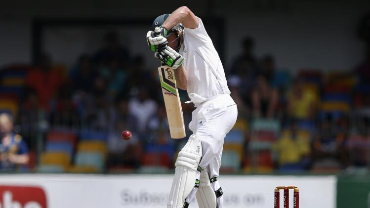 South Africa's de Villiers jumps to play a shot during the third day of their second test cricket match against Sri Lanka in Colombo