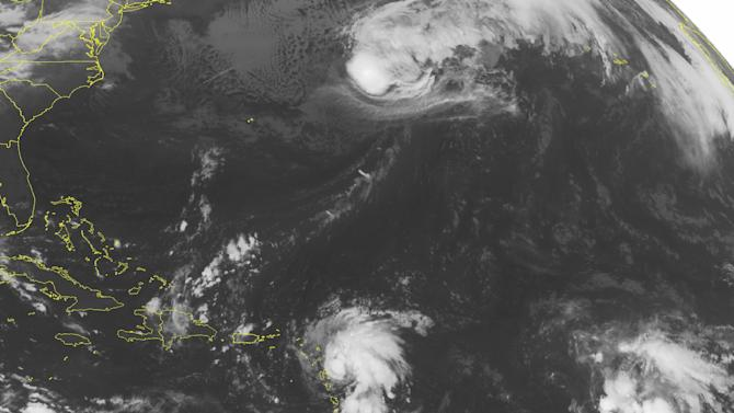 This NOAA satellite image taken Monday, Oct, 13, 2014, at 01:45 AM EDT shows Tropical Storm Gonzalo over the Antilles producing strong winds, thunderstorms and heavy rain. A few more thunderstorms have developed over Hispaniola and the southern Bahamas as well from the tropical flow. (AP Photo/NOAA via Weather Underground)