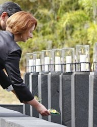 Australian Prime Minister Julia Gillard places a flower into a pond during a ceremony marking the 10th anniversary of the Bali attacks in Jimbaran. Hundreds of survivors and relatives of the dead on Friday paid tearful tributes to the 202 people killed in the Bali bombings 10 years ago, when Islamist extremists unleashed terror on partying tourists