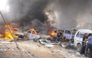 Vehicles burn after an explosion at central Damascus February 21, 2013, in this handout photograph released by Syria&#39;s national news agency SANA. The big explosion shook the central Damascus district of Mazraa on Thursday, residents said, and Syrian state media blamed what it said was a suicide bombing on &quot;terrorists&quot; battling President Bashar al-Assad. Syrian television broadcast footage of at least four bodies strewn along a main street and firefighters dousing the charred remains of dozens of burning vehicles. Black smoke billowed into the sky. REUTERS/Sana