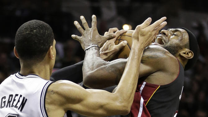 Miami Heat's LeBron James (6) is defended by San Antonio Spurs' Danny Green during the second half at Game 5 of the NBA Finals basketball series, Sunday, June 16, 2013, in San Antonio. (AP Photo/Eric Gay)