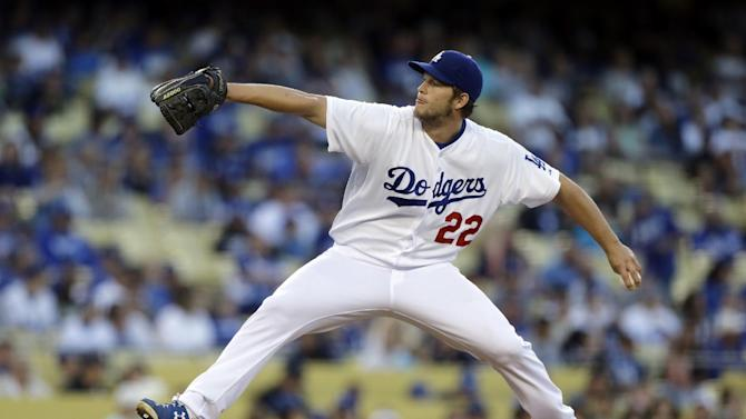 Los Angeles Dodgers starter Clayton Kershaw pitches to the Washington Nationals in the first inning of a baseball game in Los Angeles Tuesday, May 14, 2013. (AP Photo/Reed Saxon)