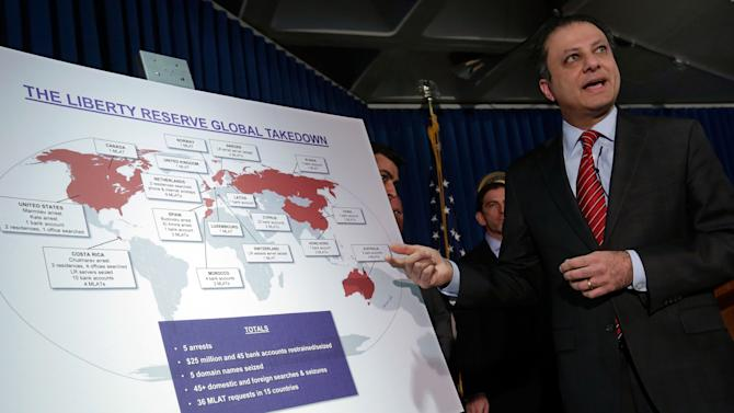 """Preet Bharara, U.S. Attorney for the Southern District of New York, describes a chart showing the global interests of Liberty Reserve, during a news conference in New York, Tuesday, May 28, 2013. Arthur Budovsky,the founder of Liberty Reserve, was indicted in the United States along with six other people in a $6 billion money-laundering scheme described as """"staggering"""" in its scope, authorities said Tuesday.(AP Photo/Richard Drew)"""