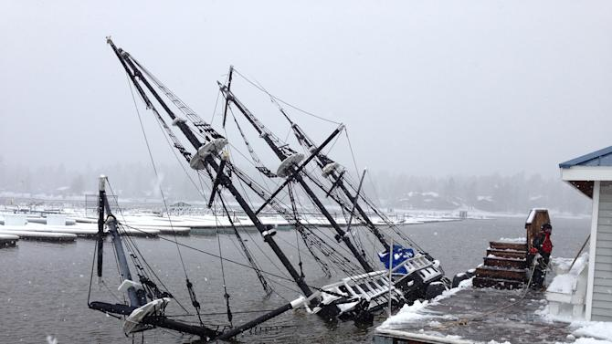"""This Saturday, March 1, 2014 photo provided by the Big Bear Visitors Bureau shows a 43-foot pirate ship tour boat partially submerged under water in Big Bear Lake, Calif. The 27-ton boat had been docked at Holloway Marina before sinking. The one-third scale 16th century Spanish galleon replica was a prop in the movie """"Time Bandits."""" (AP Photo/Big Bear Visitors Bureau)"""