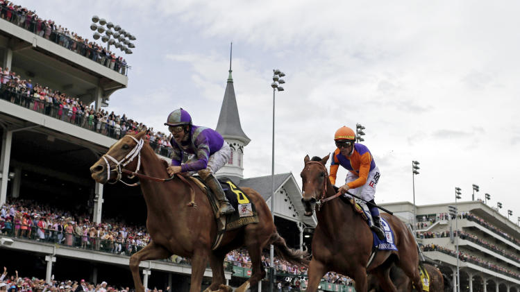 Mike Smith rides Princess of Sylmar to a win over Beholder ridden by Garrett Gomez in the 139th Kentucky Oaks at Churchill Downs Friday, May 3, 2013, in Louisville, Ky. (AP Photo/David J. Phillip)