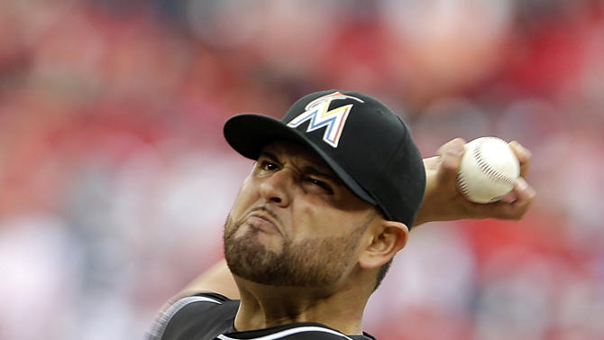 Miami Marlins starting pitcher Ricky Nolasco (47) throws during the first inning of the opening day baseball game against the Washington Nationals in Washington, on Monday, April 1, 2013.  (AP Photo/Alex Brandon)