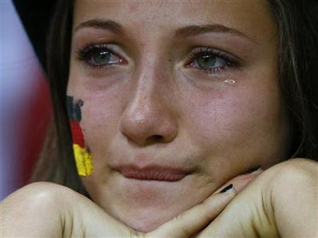 Germany soccer fan cries after Italy won the Euro 2012 semi-final soccer match against Germany at the National stadium in Warsaw
