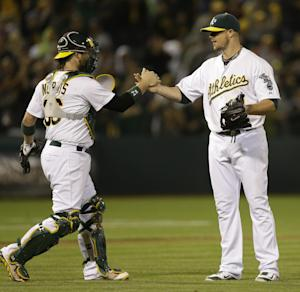 Lester goes the distance in A's 3-0 win over Twins