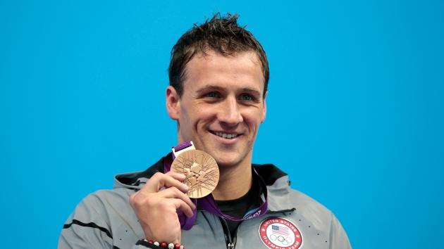Ryan Lochte is all smiles at the medal ceremony the Men's 200m Individual Medley final on Day 6 of the London 2012 Olympic Games at the Aquatics Centre in London on August 2, 2012  -- Getty Images