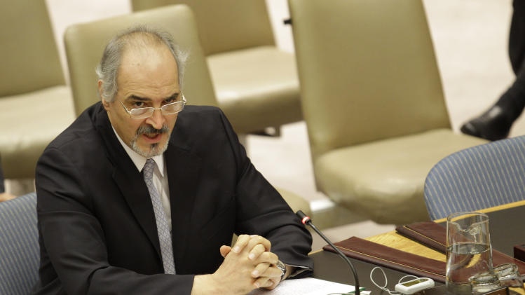 Syria's U.N. Ambassador Bashar Ja'afari speaks during a Security Council meeting on the situation in Syria at the United Nations, Thursday, July 19, 2012.  (AP Photo/Kathy Willens)