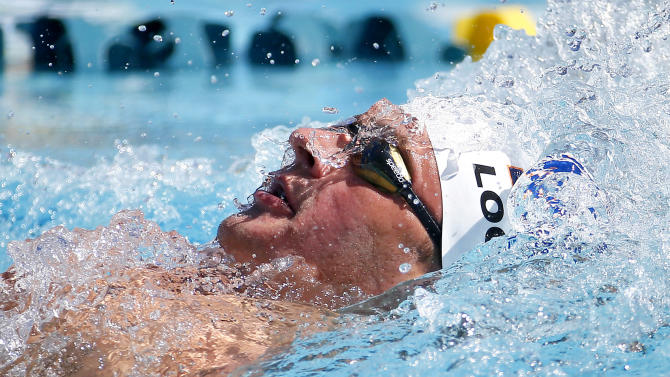 Ryan Lochte competes in the men's 200-meter individual medley preliminary, Saturday, April 18, 2015, at the Arena Pro Swim Series in Mesa, Ariz.  Lochte finished first in the heat. (AP Photo/Matt York)