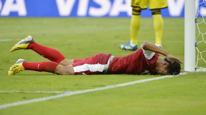 Tahiti's Steevy Chong Hue reacts after missing a chance during the soccer Confederations Cup group B match between Tahiti and Nigeria in Belo Horizonte, Brazil, Monday, June 17, 2013. (AP Photo/Eugenio Savio)