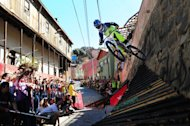 "Argentina's downhill rider Pablo Seawald participates in the final of the ""Valparaiso Cerro Abajo 2012"" (Valparaiso Downhill 2012) downhill race in Valparaiso, Chile on February 19,2012. The race is in its 10th edition with 55 riders from the US, France, Canada, Brazil, Ecuador, Argentina and Chile. AFP PHOTO / Claudio SANTANA"