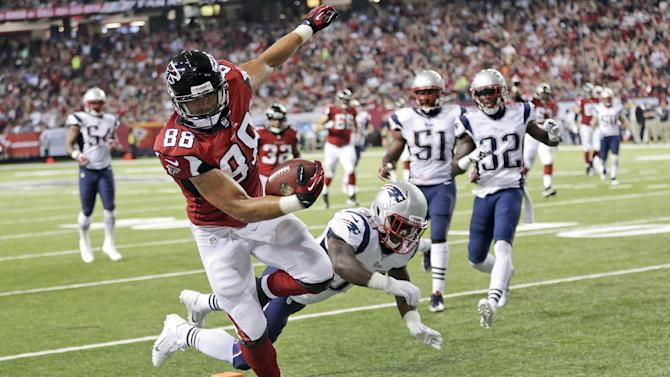 Gonzalez glad to still be with struggling Falcons